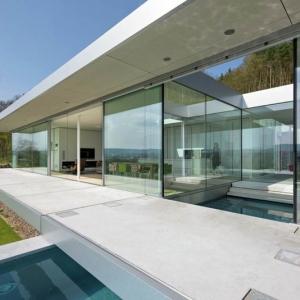 تصویر - خانه شیشه ای بر فراز دره ای سرسبز ، اثر تیم معماری Paul de Ruiter ، آلمان - معماری