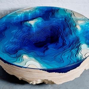 عکس - میز قهوه خوری که شما را به عمق اقیانوس می برد.