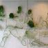عکس - اثری هنری با ترکیب فولاد و گیاهان سبز