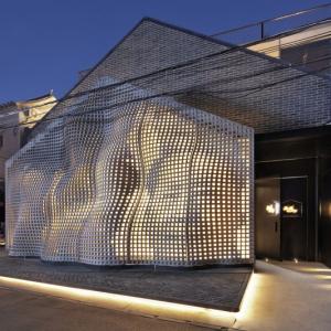 عکس - تصویری از مائو بر پوسته بتنی اجرا شده ساختمانی در پکن